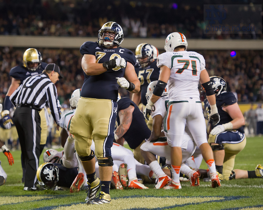 Oct. 6, 2012; Offensive tackle Zack Martin (70) celebrates after an Irish touchdown in the 41-3 win over Miami in the Shamrock Series game...Photo by Matt Cashore/University of Notre Dame