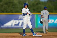 Angelo Castellano (13) of the Burlington Royals smiles as he stands on second base after hitting a double against the Bluefield Blue Jays at Burlington Athletic Park on June 29, 2015 in Burlington, North Carolina.  The Royals defeated the Blue Jays 4-1. (Brian Westerholt/Four Seam Images)