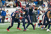 FOXBORO, MA - OCTOBER 10: New England Patriots Quarterback Tom Brady (12) passes the ball to New England Patriots Runningback Sony Michel (26) during a game between New York Giants and New England Patriots at Gillettes on October 10, 2019 in Foxboro, Massachusetts.