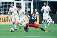 FOXBOROUGH, MA - MAY 1: Michael Mancienne #13 of New England Revolution tackles Emerson Hyndman #20 Midfielder of Atlanta United FC during a game between Atlanta United FC and New England Revolution at Gillette Stadium on May 1, 2021 in Foxborough, Massachusetts.