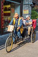 Yangzhou, Jiangsu, China.  Man-powered Tricycle Transport in Dong Guan Street.