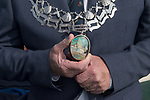 """Frank Pomroy Deputy Cinq Port Liberty of Brightlingsea, the chain of office 2021.<br /> Frank Pomroy wears the solid silver Deputy's badge and chain of office.  The opal carved with a seascape is believed to be the largest carved opal in the world.  The solid silver chain is made up of alternate links of oysters and crossed sprats, along with the  names of all the other holders of this office. The motto immediately above the opal is in Latin. Its says, """"For a beautiful wife and an even more beautiful daughter.""""  Presented to Brightlingsea by John Bateman the first Deputy in the 1887."""
