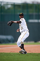 GCL Pirates third baseman Johan De Jesus (27) throws to first during a game against the GCL Phillies on August 6, 2016 at Pirate City in Bradenton, Florida.  GCL Phillies defeated the GCL Pirates 4-1.  (Mike Janes/Four Seam Images)