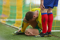 20th March 2021; Carrow Road, Norwich, Norfolk, England, English Football League Championship Football, Norwich versus Blackburn Rovers; Ben Gibson of Norwich City goes down injured and was stretchered off