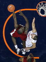 CHARLOTTESVILLE, VA- NOVEMBER 13: Presano Bell #20 of the South Carolina State Bulldogs shoots over Thomas Rogers #30 of the Virginia Cavaliers during the game on November 13, 2011 at the John Paul Jones Arena in Charlottesville, Virginia. Virginia defeated South Carolina State 75-38. (Photo by Andrew Shurtleff/Getty Images) *** Local Caption *** Presano Bell;Thomas Rogers