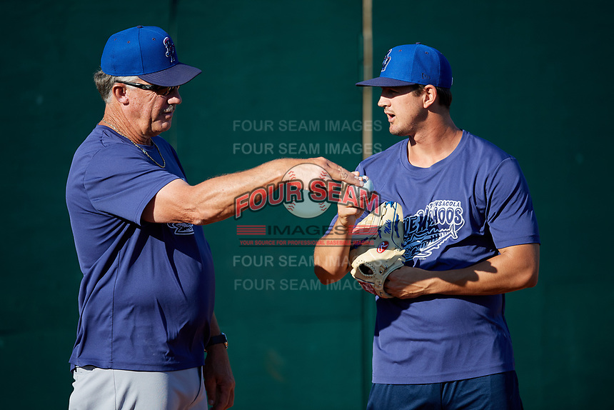 Pensacola Blue Wahoos pitcher Tyler Mahle (31) talks with pitching coach Danny Darwin (44) before  a game against the Mobile BayBears on April 25, 2017 at Hank Aaron Stadium in Mobile, Alabama.  Mobile defeated Pensacola 3-0.  (Mike Janes/Four Seam Images)