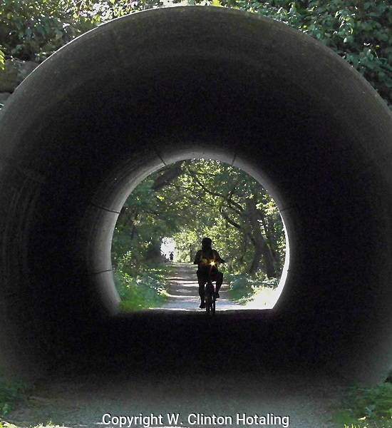 A cyclist comes under a road along the Glacial Drumlin Trail in Jefferson County, Wisconsin
