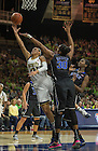 Feb. 21, 2014; Guard Kayla McBride shoots past Duke forward Amber Henson during the second half. Notre Dame won 81 to 70. Photo by Barbara Johnston/University of Notre Dame