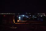 DOMIZ, IRAQ: The Domiz refugee camp at night....Over 7,000 Syrian Kurds have fled the violence in Syria and are living in the Domiz refugee camp in the semi-autonomous region of Iraqi Kurdistan...Photo by Ali Arkady/Metrography