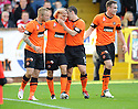 United's John Rankin is congratulated after he scores united's first    ...