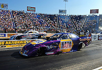 Jul, 8, 2011; Joliet, IL, USA: NHRA funny car driver Ron Capps (near lane)alongside Matt Hagan during qualifying for the Route 66 Nationals at Route 66 Raceway. Mandatory Credit: Mark J. Rebilas-