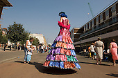 A stilt walker at Church Street Summer Festival 2005, Paddington, London.