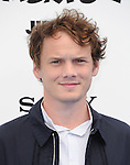 Anton Yelchin at The Columbia Pictures and Sony Pictures Animation L.A. Premiere of The Smurfs 2 held at The Regency Village Theatre in Westwood, California on July 28,2013                                                                   Copyright 2013 Hollywood Press Agency