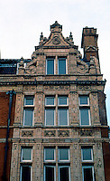 London: Chapel Place North and S. Audley St., Mayfair. Buff terra cotta and red brick, 1893.
