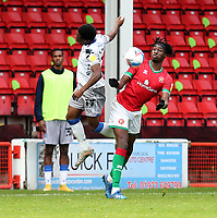 10th October 2020; Bescot Stadium, Walsall, West Midlands, England; English Football League Two, Walsall FC versus Colchester United; Elijah Debayo of Walsall challenges for the aerial ball with Miquel Scarlett of Colchester United