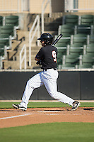 Christian Stringer (9) of the Kannapolis Intimidators follows through on his swing against the West Virginia Power at CMC-Northeast Stadium on April 21, 2015 in Kannapolis, North Carolina.  The Power defeated the Intimidators 5-3 in game one of a double-header.  (Brian Westerholt/Four Seam Images)