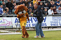 A fan celebrates with club mascot Spytty after Mickey Demetriou of Newport County scores his sides first goal of the match from a penalty during the Sky Bet League Two match between Newport County and Notts County at Rodney Parade, Newport, Wales, UK. Saturday 06 May 2017
