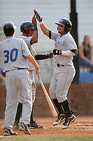 Bluefield Blue Jays right fielder Kevin Pillar #5 is greeted at home after hitting a home run during the first game of the 2011 Championship Series between the Bluefield Blue Jays and the Johnson City Cardinals at Howard Johnson Field on September 3, 2011 in Johnson City, Tennessee.  The Cardinals won the game 4-3.  (Tony Farlow/Four Seam Images)
