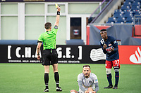 FOXBOROUGH, MA - APRIL 17: Referee Thomas Snyder issues a yellow card to Luis Caicedo #27 of New England Revolution II during a game between Richmond Kickers and Revolution II at Gillette Stadium on April 17, 2021 in Foxborough, Massachusetts.