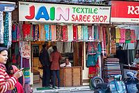 India, Dehradun.  Young Couple Shopping in a Saree Shop.