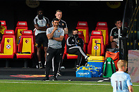 Watford caretaker manager Hayden Mullins looks on during the Premier League match between Watford and Manchester City at Vicarage Road, Watford, England on 21 July 2020. Football Stadiums around remain empty due to the Covid-19 Pandemic as Government social distancing laws prohibit supporters inside venues resulting in all fixtures being played behind closed doors until further notice.<br /> Photo by Andy Rowland.
