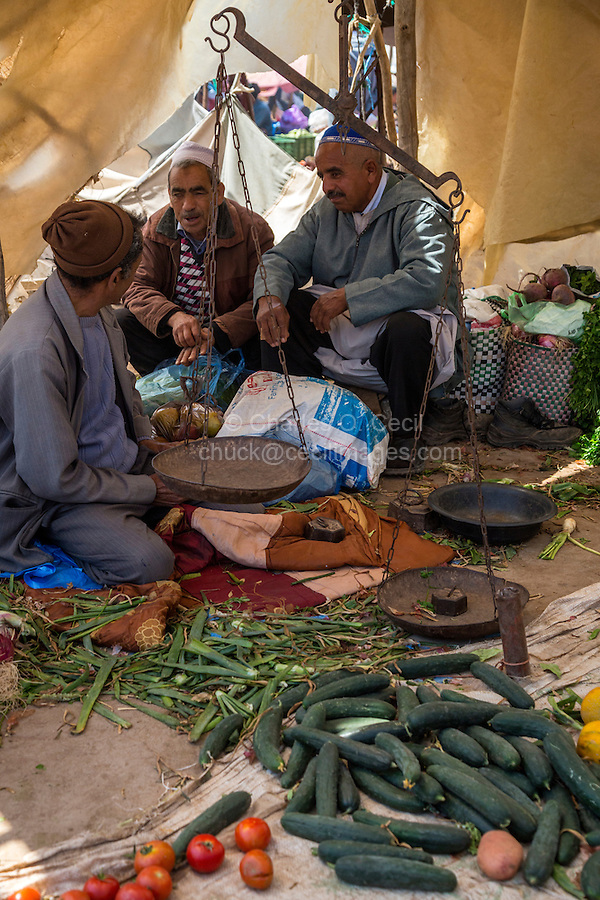 Morocco.  Vegetable Vendors Talking in the Marketplace, Had Draa Market, Essaouira Province.