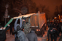 """""""Titushki"""",  supporters of the  president in charge Yanukovich, help police forces during the  nightly operations by dismamtling the protester's  barricades in the government district. Kiev, Ukraine"""