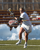 Boston College attacker Covie Stanwick (8) on the attack. .Boston College (white) defeated Boston University (red), 12-9, on the Newton Campus Lacrosse Field at Boston College, on March 20, 2013.