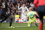 James Rodriguez of Real Madrid competes with Goalkeeper Pepe Reina of SSC Napoli during the match Real Madrid vs Napoli, part of the 2016-17 UEFA Champions League Round of 16 at the Santiago Bernabeu Stadium on 15 February 2017 in Madrid, Spain. Photo by Diego Gonzalez Souto / Power Sport Images
