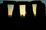 Stonehenge Wiltshire June 21st dawn sunrise. over the Heel Stone at the summer solstice. 1970s.
