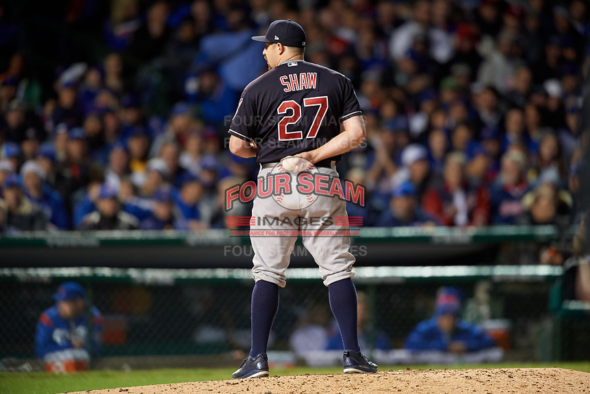 Cleveland Indians pitcher Bryan Shaw (27) looks in for the sign in the sixth inning during Game 5 of the Major League Baseball World Series against the Chicago Cubs on October 30, 2016 at Wrigley Field in Chicago, Illinois.  (Mike Janes/Four Seam Images)