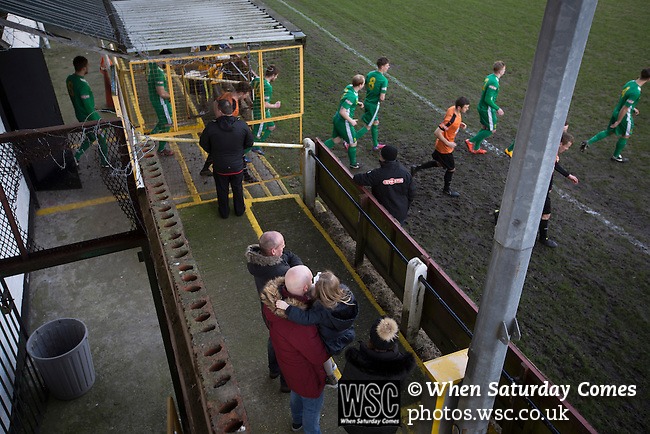 Prescot Cables 2 Brighouse Town 1, 13/02/2016. Hope Street, Northern Premier League. The two teams coming on to the pitch before Prescot Cables (in orange) played Brighouse Town in a Northern Premier League division one north fixture at Valerie Park. Founded in 1884, the 'Cables' in their name came from the largest local employer, British Insulated Cables and they have played in their current ground, also known as Hope Street, since 1906. Prescott won the match 2-1 watched by a crowd of 189. Photo by Colin McPherson.