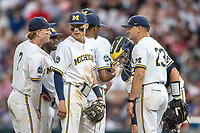 Michigan Wolverines head coach Erik Bakich (23) meets with his infield on the mound against the Vanderbilt Commodores during Game 2 of the NCAA College World Series Finals on June 25, 2019 at TD Ameritrade Park in Omaha, Nebraska. Vanderbilt defeated Michigan 4-1. (Andrew Woolley/Four Seam Images)
