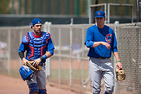 Chicago Cubs catcher Will Remillard (5) and starting pitcher Duncan Robinson (40) walk onto the field before a Minor League Spring Training game against the Colorado Rockies at Sloan Park on March 27, 2018 in Mesa, Arizona. (Zachary Lucy/Four Seam Images)