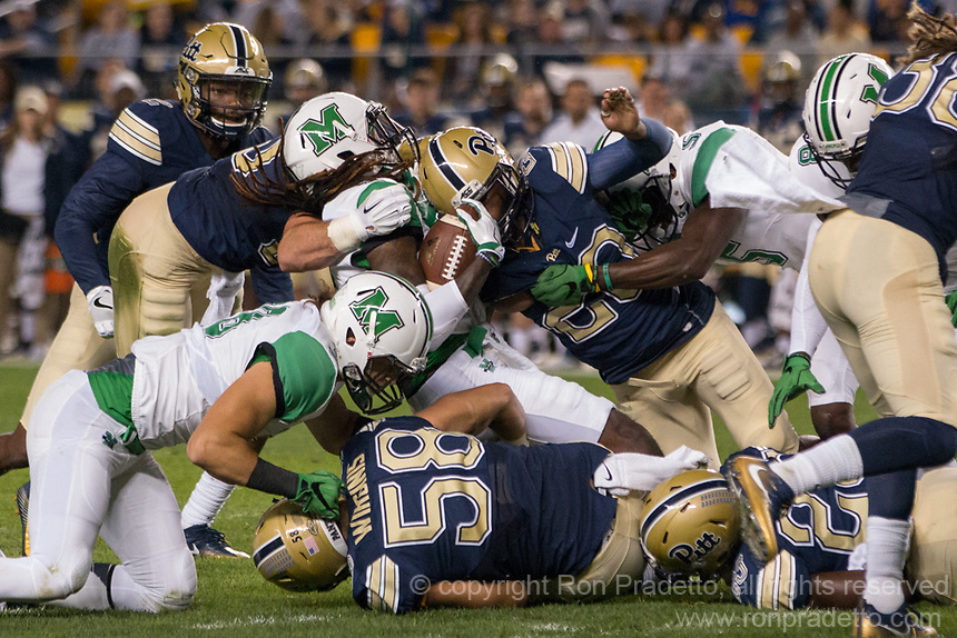 The Pitt defense makes a swarm tackle. The Pitt Panthers defeated the Marshall Thundering Herd 43-27 on October 1, 2016 at Heinz Field in Pittsburgh, Pennsylvania.