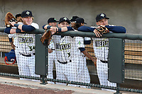 Left fielder Tim Tebow (15) of the Columbia Fireflies, right, with teammates Michael Paez (3) and Dash Winningham (34) prior to the start of his first Class A game against the Augusta GreenJackets on Opening Day, Thursday, April 6, 2017, at Spirit Communications Park in Columbia, South Carolina. (Tom Priddy/Four Seam Images)