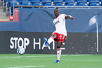 FOXBOROUGH, MA - JUNE 26: Caiser Gomes #4 of North Texas SC crosses the ball during a game between North Texas SC and New England Revolution II at Gillette Stadium on June 26, 2021 in Foxborough, Massachusetts.