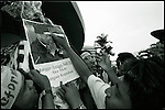 Summer '98-- Jakarta, Indonesia -- Students cross out a picture of President Suharto at the MPR to protest his fuel hike and shooting a students during a protest that pushed the city into anarchy and triggering his resigning from office.