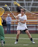 Boston College attacker Brooke Blue (4) scoring shot. Boston College defeated University of Vermont, 15-9, at Newton Campus Field, April 4, 2012.