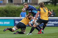 Mark Bright (Captain) of London Scottish (centre) is tackled during the Greene King IPA Championship match between London Scottish Football Club and Ealing Trailfinders at Richmond Athletic Ground, Richmond, United Kingdom on 8 September 2018. Photo by David Horn.