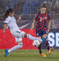 EAST HARTFORD, CT - JULY 1: Daniela Espinosa #7 of Mexico defends Kristie Mewis #6 of the USWNT during a game between Mexico and USWNT at Rentschler Field on July 1, 2021 in East Hartford, Connecticut.