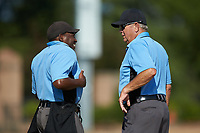 Home plate umpire Marcus Neal (left) chats with base umpire Tommy Caudle (right) between innings of the game between the Statesville Owls and the High Point-Thomasville HiToms at Finch Field on July 19, 2020 in Thomasville, NC. The HiToms defeated the Owls 21-0. (Brian Westerholt/Four Seam Images)