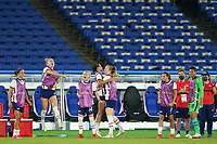 YOKOHAMA, JAPAN - JULY 30: Players of the United States on the bench celebrate a save from Goalkeeper Alyssa Naeher #1 of the United States during a game between Netherlands and USWNT at International Stadium Yokohama on July 30, 2021 in Yokohama, Japan.