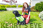 Niamh O'Regan at home in Tralee on Friday with her guide dog puppy, 11 month old Labrador Regan. Niamh is the youngest puppy trainer in Kerry and is the artist who is sketching a winning portrait of a dog for the Irish Guide Dogs Association