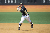 Wake Forest Demon Deacons second baseman Nate Mondou (10) makes a throw to first base against the Miami Hurricanes at Wake Forest Baseball Park on March 22, 2015 in Winston-Salem, North Carolina.  The Demon Deacons defeated the Hurricanes 10-4.  (Brian Westerholt/Four Seam Images)