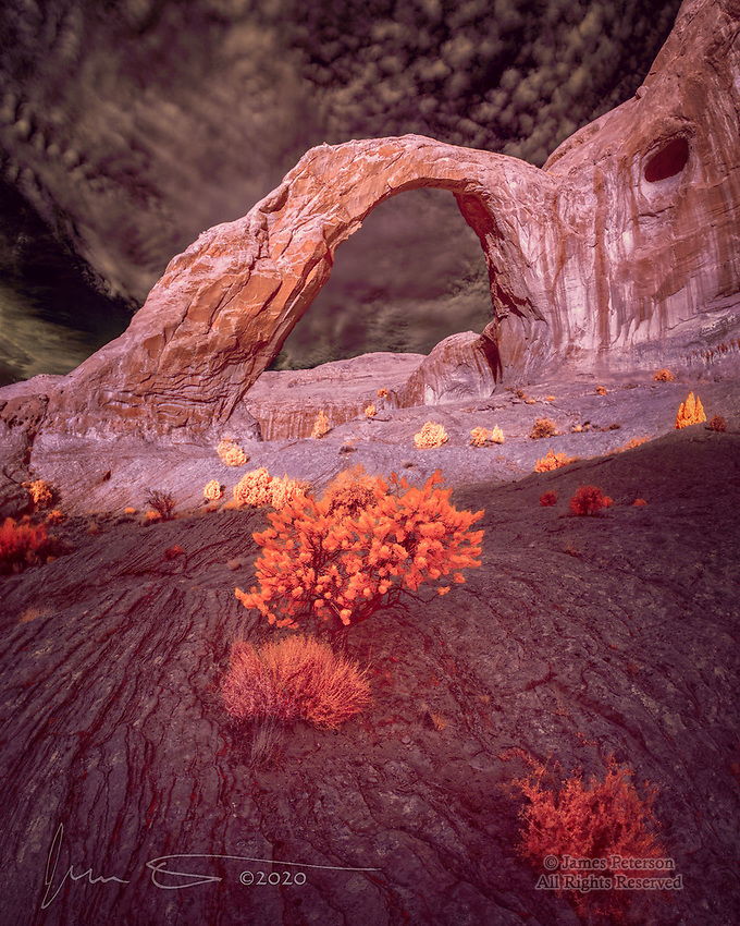 October Morning at Corona Arch (Infrared).  If you were fortunate enough to have been at Corona Arch at daybreak on a certain morning back in October – and if you happened to have infrared eyes – this is what you might have seen.   This arch is reached via a moderately rugged trail that threads along a canyon wall southwest of Moab, Utah.<br /> <br /> Image ©2020 James D. Peterson