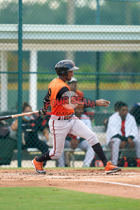 FCL Orioles Orange Luis Sena (9) bats during a game against the FCL Pirates Black on July 26, 2021 at Pirate City in Bradenton, Florida.  (Mike Janes/Four Seam Images)