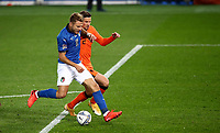 Italy's Ciro Immobile, left, is challenged by Netherlands's Hans Hateboer during the UEFA Nations League football match between Italy and Netherlands at Bergamo's Atleti Azzurri d'Italia stadium, October 14, 2020.<br /> UPDATE IMAGES PRESS/Isabella Bonotto
