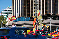 MADRID, SPAIN - OCTOBER 12: A couple of kids wave Spanish flags over a car during a protest against the Government summoned by VOX, Spanish far-right party and third biggest party in the Parliament, on 12 October 2020, in Madrid, Spain. The demonstration coincides with the National Day in Spain after the Government declared state of alarm in the Madrid region on previous Friday to slow down the high Covid-19 cases in some municipalities of this region. (Photo by Sergio Belena/VIEWpress via Getty Images).
