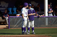 Jordan Sergent (9) of the High Point Panthers chats with third base coach Kenny Smith during the game against the NJIT Highlanders at Williard Stadium on February 19, 2017 in High Point, North Carolina. The Panthers defeated the Highlanders 6-5. (Brian Westerholt/Four Seam Images)